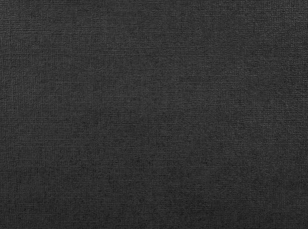 Trama di carta nera. sfondo di materiale scuro realizzato in cartone. Foto Premium