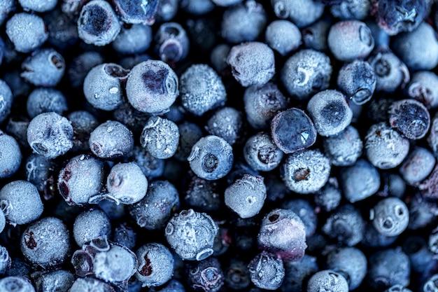 Trama di mirtilli congelati. frutti di bosco congelati Foto Premium