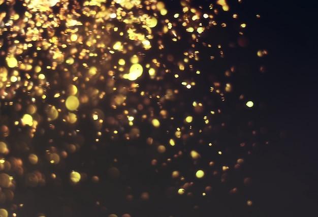 Trama di scintillio dorato colorfull offuscata sfondo astratto per la vigilia di natale capodanno o natale Foto Premium