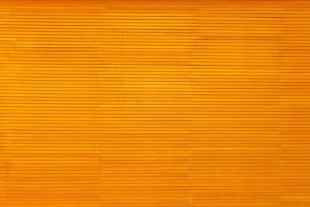 Trama di sfondo in legno giallo Foto Premium
