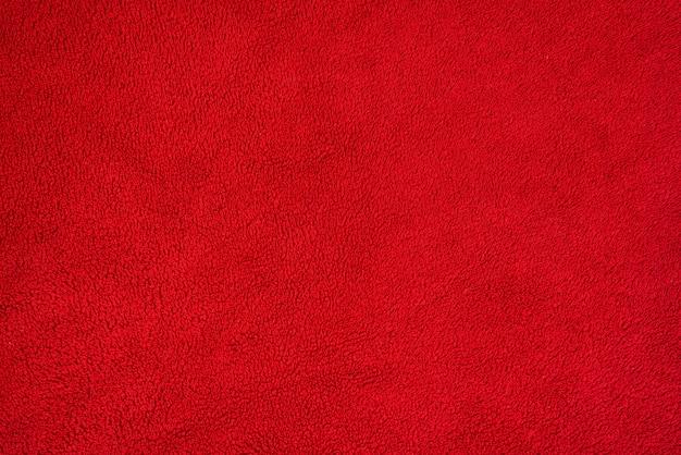 Trama di sfondo liscio di un asciugamano di spugna. colore rosso Foto Premium