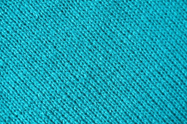 Trama di tessuto di lana lavorato a maglia alpaca colorato blu turchese Foto Premium