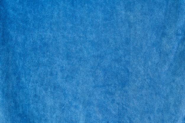 Trama di tessuto di sfondo denim liscio. colore blu scuro Foto Premium