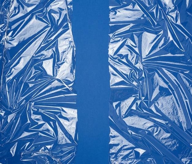 Trama di una pellicola di plastica trasparente che si estende per prodotti da imballaggio Foto Premium