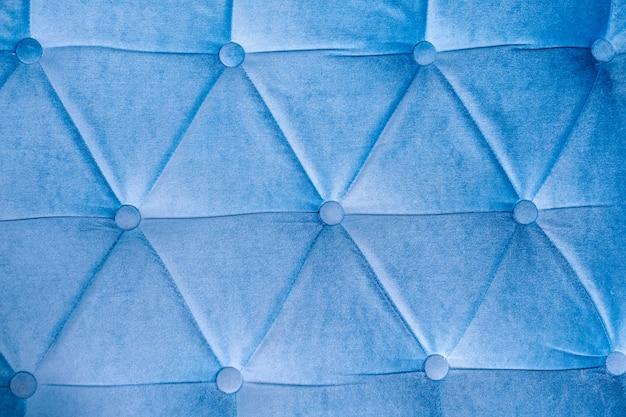 Trama in pelle blu con rivetti con posto per il testo Foto Premium
