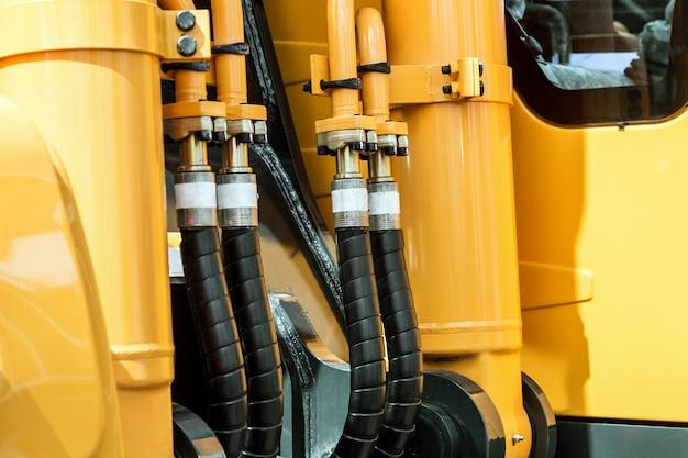 Trattore idraulico giallo Foto Premium