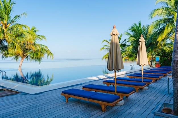 Travel alberghi di lusso ombrello rilassamento Foto Gratuite