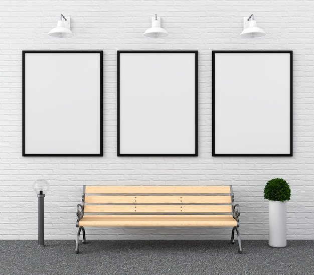 Tre cornice vuota per mockup sul muro Foto Premium