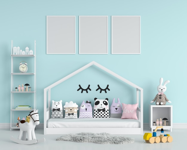 Tre cornici vuote per il modello nella camera da letto del bambino Foto Premium