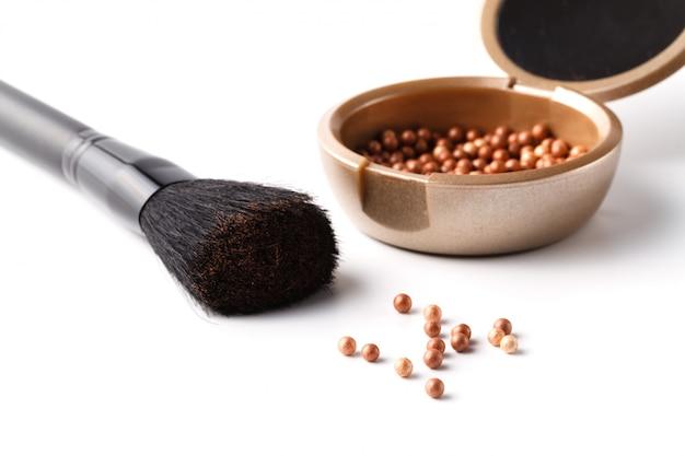 Trucco in polvere e pennello Foto Premium