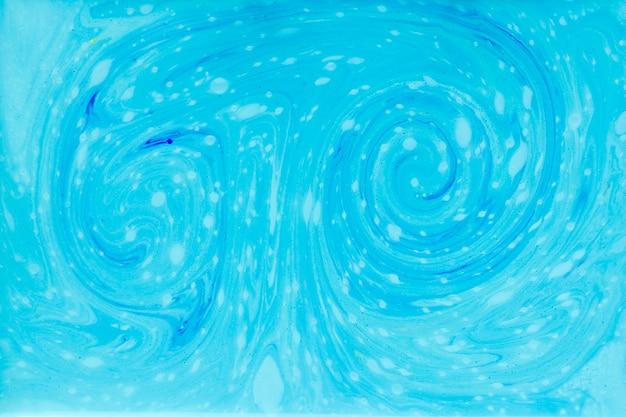 Turbinio di vernice blu nel liquido Foto Gratuite