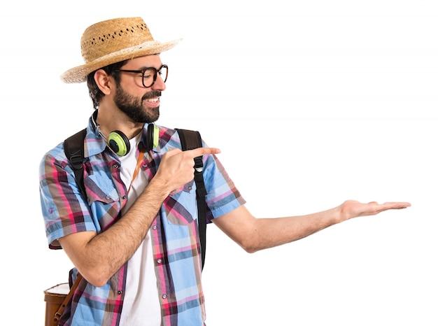 Turista che tiene qualcosa Foto Gratuite