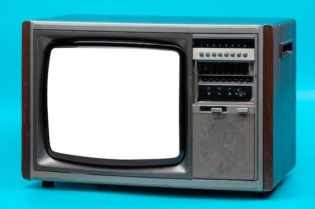 Tv dell'annata isolata sul blu Foto Premium