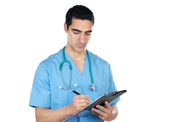 Un giovane medico su sfondo bianco Foto Premium