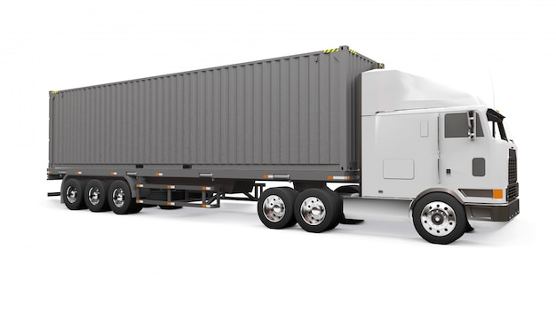 Un grande camion bianco retrò con una parte per dormire e un'estensione aerodinamica trasporta un rimorchio con un container marittimo Foto Premium