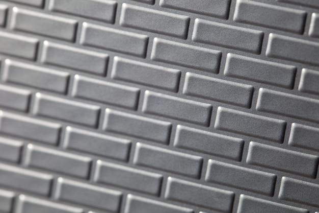Un muro formato da mattoni di metallo Foto Premium