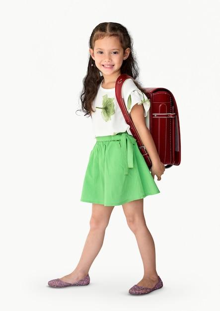 Una ragazza sorridente con uno zaino scuola Foto Premium