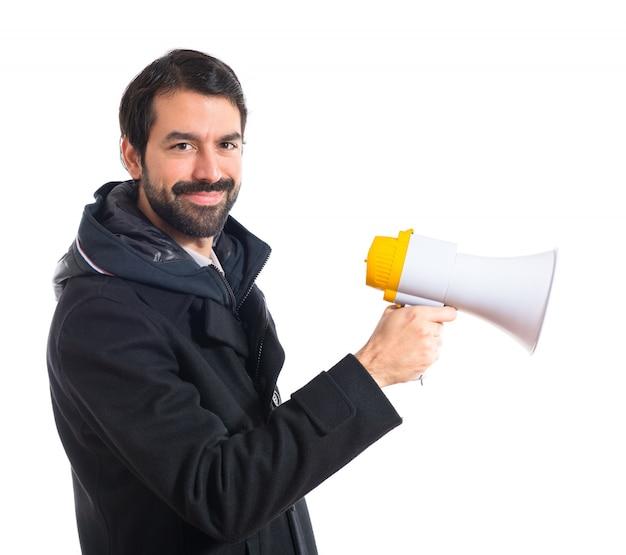 Uomo che grida per megafono Foto Gratuite