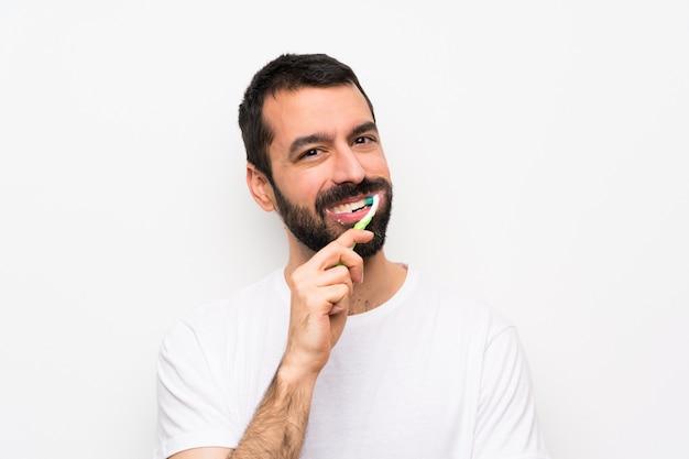 Uomo con barba lavarsi i denti Foto Premium