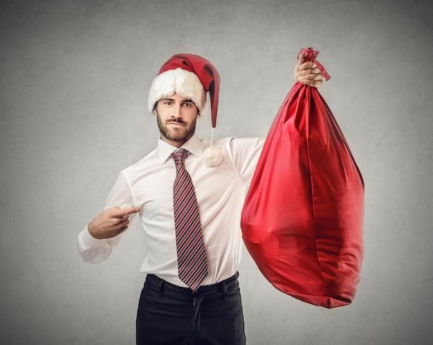 Uomo con cappello di babbo natale Foto Premium