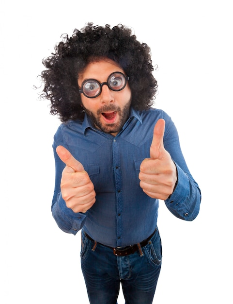 Uomo con espressione pazza e pollice in su Foto Premium