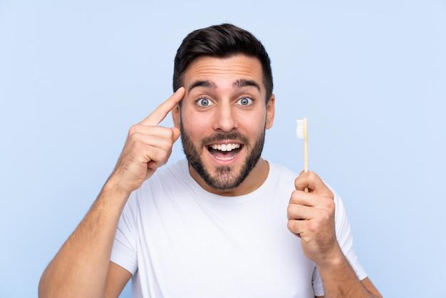 Uomo con uno spazzolino da denti Foto Premium