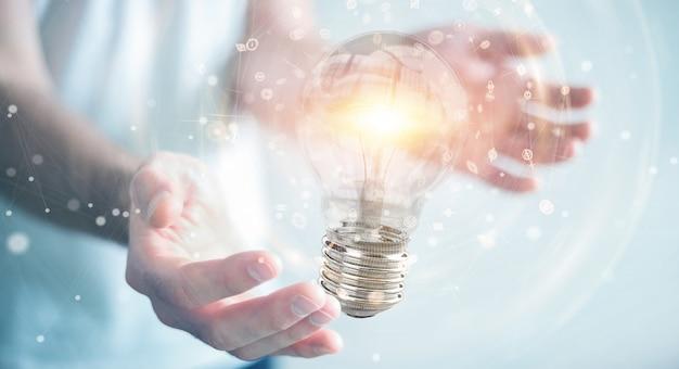 Uomo d'affari che collega le lampadine moderne con le connessioni Foto Premium