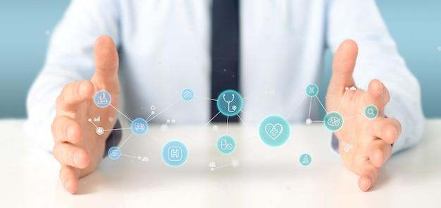 Uomo d'affari che tiene rappresentazione medica dell'icona e del collegamento 3d Foto Premium