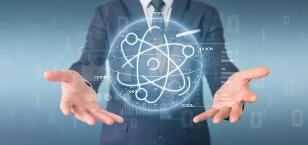 Uomo d'affari che tiene un'icona di atomo circondato da dati Foto Premium