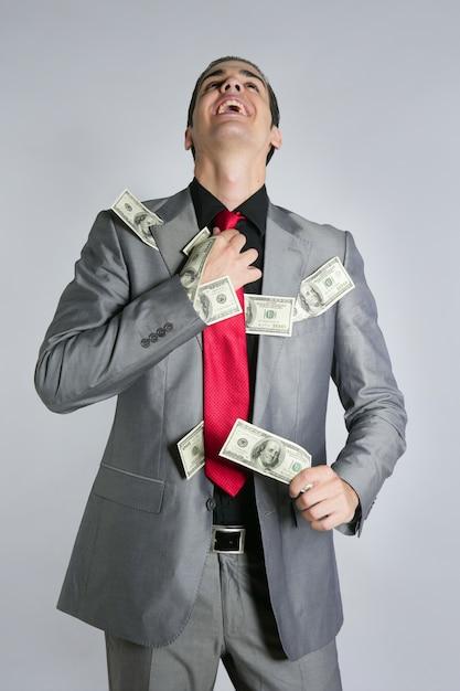 Uomo d'affari con il vestito e il legame delle note del dollaro Foto Premium