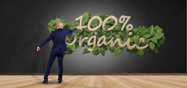Uomo d'affari davanti ad un logo di legno 100% organico con le foglie intorno alla rappresentazione 3d Foto Premium