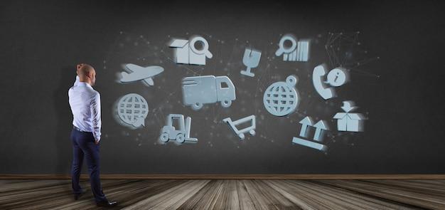Uomo d'affari davanti ad un'organizzazione logistica con la rappresentazione della connessione 3d e dell'icona Foto Premium