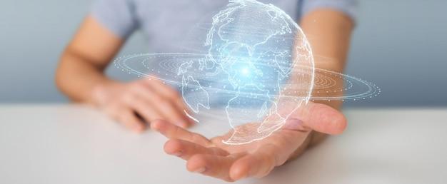 Uomo d'affari facendo uso dell'ologramma della rete del globo con la mappa dell'america sua Foto Premium