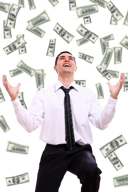 Uomo d'affari felice e banconote in dollari volanti Foto Gratuite
