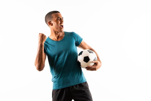 Uomo del giocatore di football americano afro Foto Premium
