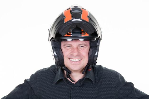 Uomo in abito da moto e casco da portare Foto Premium