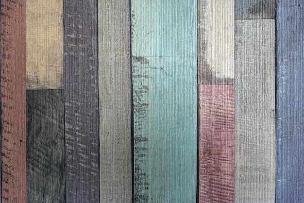 Vecchia struttura di legno variopinta d'annata del fondo della parete Foto Premium