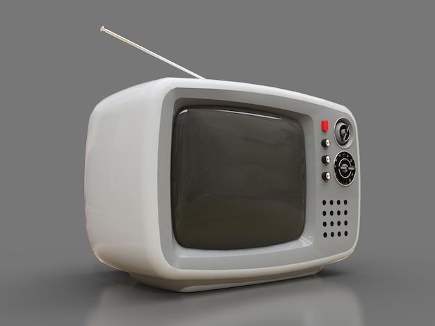 Vecchia tv bianca sveglia con l'antenna su un fondo grigio Foto Premium