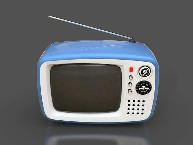 Vecchia tv blu sveglia con l'antenna su una superficie grigia Foto Premium