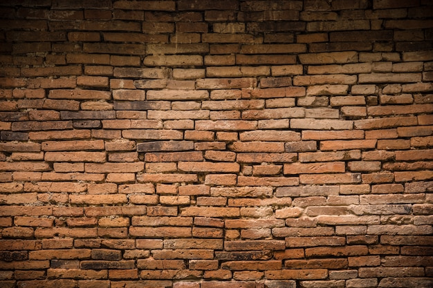 Vecchio fondo decadente del vecchio muro di mattoni Foto Premium