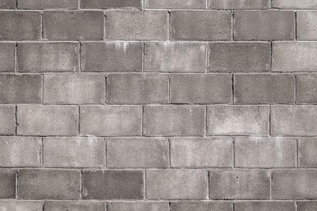 Vecchio fondo di struttura della parete dei blocchi in calcestruzzo. Foto Premium