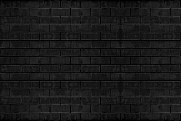 Vecchio fondo stagionato della superficie di struttura della parete dei blocchetti del mattone del nero scuro del cemento. Foto Premium