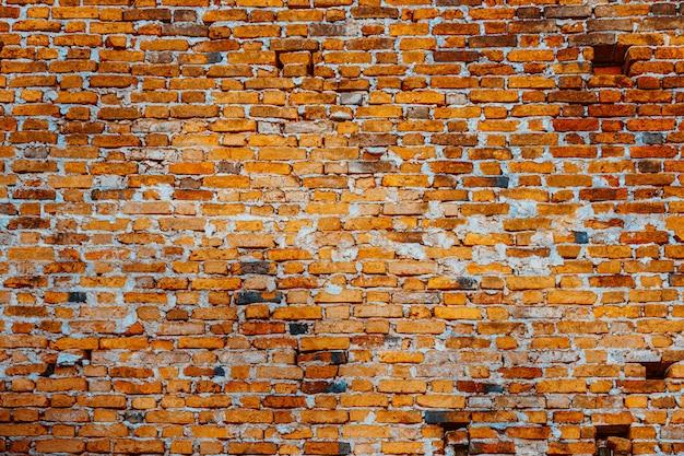 Vecchio muro di mattoni rossi per trama .. Foto Premium