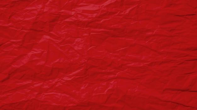 Vecchio sgualcito rosso con il fondo approssimativo di struttura di carta della pagina. piega grunge pergamena modello vintage design. Foto Premium
