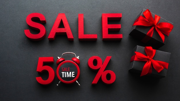 Vendita sconto del cinquanta per cento con l'orologio Foto Gratuite