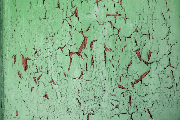 Verde chiaro desaturato, menta vecchio stressato, esposto alle intemperie, incrinato rusic dipinto esterno tavole di legno normale texture di sfondo Foto Premium