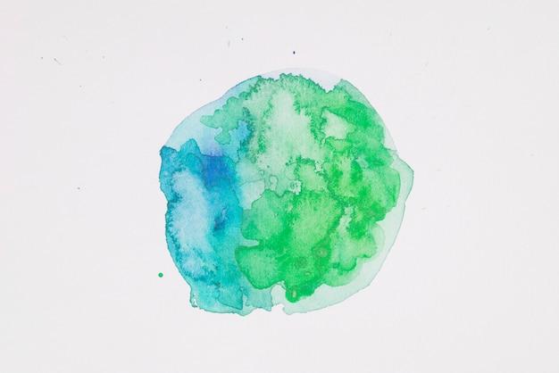 Vernici verdi e acquamarina a forma di cerchio su carta bianca Foto Gratuite