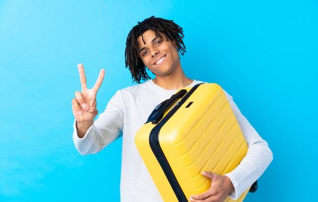 Viaggiatore con valigia Foto Premium
