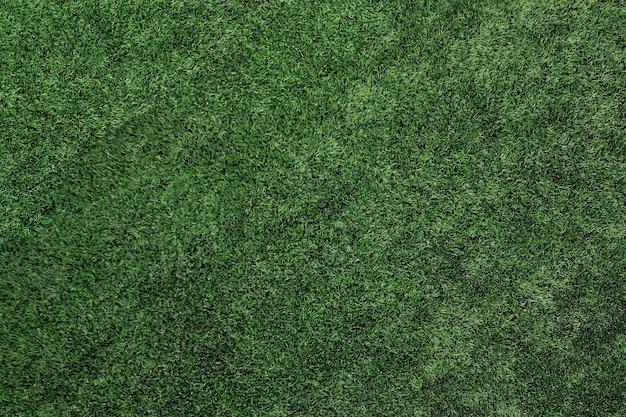 Vista dall'alto di erba artificiale, trama di prato verde artificiale. Foto Premium