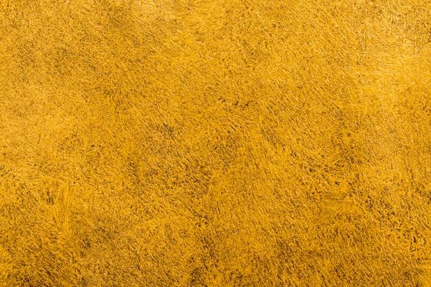 Vista dall'alto elegante sfondo dorato Foto Gratuite